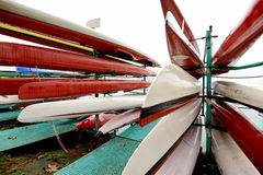 Colorful Kayaks and canoes in a Row stack Stock Photo