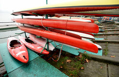 Colorful Kayaks and canoes in a Row stack Stock Image