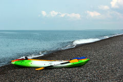Colorful kayaks and canoes on stony beach Stock Photography