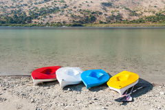Colorful kayaks on the coast of lake Royalty Free Stock Images