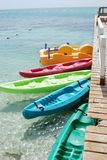 Colorful Kayaks Floating in the Water. Colorful kayas lined up in the water Stock Image