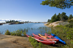 Colorful Kayaks by the Lake Stock Photography