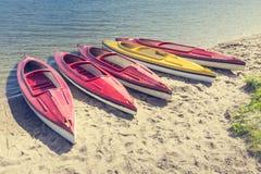 Colorful kayaks moored on lakeshore, Goldopiwo Lake, Mazury, Pol Royalty Free Stock Photography