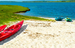 Colorful kayaks pulled up onto the sand Royalty Free Stock Photo