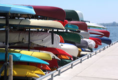 Colorful kayaks for Rent. Are stacked on the dock Royalty Free Stock Photo