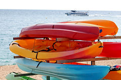 Colorful kayaks for rent on the beach Stock Images