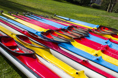 Colorful kayaks for rent. Royalty Free Stock Images
