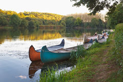 Colorful Kayaks on the river. Royalty Free Stock Photo