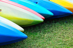Colorful kayaks in stack stock photography