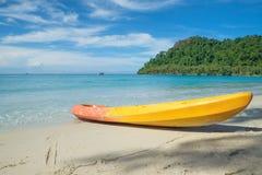 Colorful kayaks on the tropical beach Stock Photos