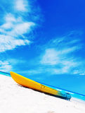 Colorful kayaks on the tropical beach Stock Images