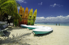 Colorful kayaks on white sandy beach at sunny day Royalty Free Stock Images