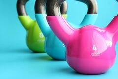 Colorful kettlebells Royalty Free Stock Photo