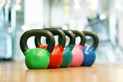 Colorful kettlebells in gym stock photography