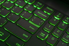 Colorful keyboard for gaming. Backlit keyboard with green color scheme. Colorful light keyboard stock photos