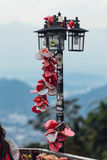 Colorful keychain holded on post lamp is called `Love Lock Penang Hill` from Penang Hill at George Town. Penang, Malaysia Stock Photo