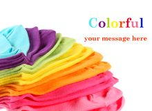 Colorful kid's ankle socks. Colorful stack of new kid's cotton socks on white, with copy space .  Focus mid-stack Royalty Free Stock Photos