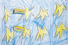 Colorful kid`s drawing of shooting stars in blue sky.  royalty free stock images