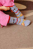 Colorful Kid Socks. A preschooler learning to dress up with cute, colorful and warm socks Royalty Free Stock Photos