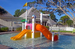 Colorful Kiddie Pool. Colorful kiddie wading pool with water slides, sprinklers and showers Royalty Free Stock Photography