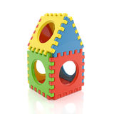 Colorful kids puzzle house with wholes isolated on white background Royalty Free Stock Photo