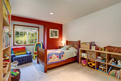 Colorful kids room interior with many toys. Royalty Free Stock Images