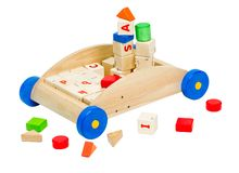 Colorful kids  toy blocks in the wooden car Royalty Free Stock Photography