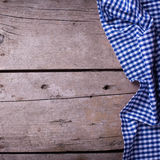 Colorful   kitchen towel on vintage  wooden background. Stock Photos
