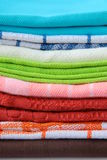 Colorful kitchen towels. Stacked on each other Stock Photos