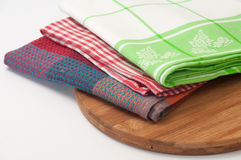 Colorful kitchen towels on a kitchen wooden board Stock Images