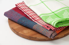 Colorful kitchen towels on a kitchen wooden board Royalty Free Stock Photo