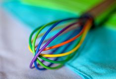 Colorful Kitchen Whisk royalty free stock image