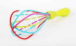 Colorful kitchen whisk Stock Photography