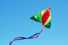 Colorful kite. In blue sky Stock Photos