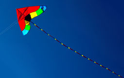 Colorful kite. Kite in red yellow and green against intense blue sky. With space for text Stock Image