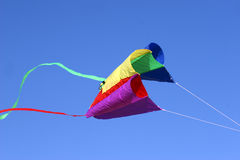 Colorful kite. Kite in red yellow and green against intense blue sky. With space for text Royalty Free Stock Photos