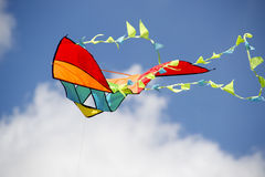 Colorful kite. Kite flying in a blurred sky with clouds Royalty Free Stock Photo