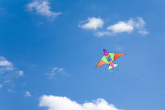 Colorful kite. Flying in a blue sky Stock Images