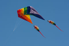 Colorful kite in the air. Flying a colorful kite in the blue sky Stock Image