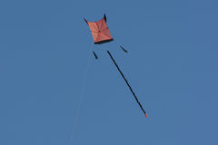 Colorful kite in the air. Flying a colorful kite in the blue sky Stock Images