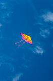 Colorful kite in blue sky Royalty Free Stock Images