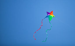 Colorful kite in the blue sky Royalty Free Stock Photos