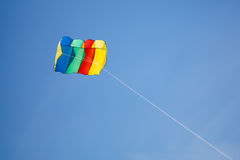 Colorful kite on blue sky background. With copy-space Stock Image