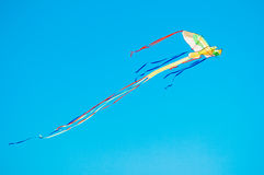 Colorful kite in the blue sky Royalty Free Stock Image