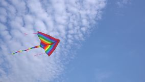 Colorful kite in the blue sky. With clouds stock video