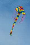 Colorful kite flying. Against the blue sky Stock Photos