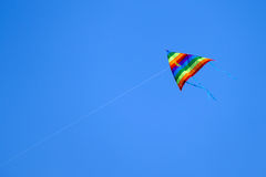 Colorful kite flying on background sky. Colorful kite flying on background blue sky Stock Image