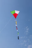 Colorful kite flying in a beautiful sky Stock Images