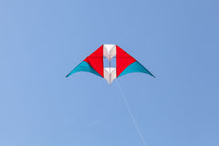 Colorful kite flying in a beautiful sky Stock Photo