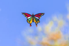 Colorful Kite Flying in Blue Sky Royalty Free Stock Photos